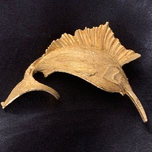 Golden fish brooch with sign????